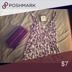 Old Navy comfy fit floral baby doll tank 🌸 Large Floral print white and purple flowy top from Old Navy. SUPER soft material. Size Large, could fit medium or maybe a little bigger as it has some stretch. Worn maybe 3 times and has been banished to my closet ever since (no longer fits, lost my tatas 😩) OH SO CUTE! Original 💰💰💰 PRICE set at $0 only because I can't recall what I originally paid. Feel free to make me an offer! Old Navy Tops Tank Tops