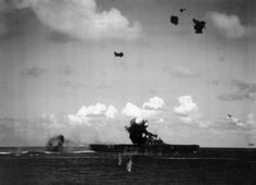 10:13 hrs. The Val dive bomber crashing into the stack on the USS Hornet CV-8. A torpedo plane can be seen having dropped it's torpedo which will hit the Hornet.