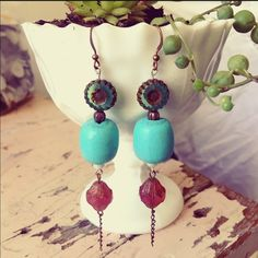Hand Painted Wood Bohemian Earrings I designed these earrings with a bohemian flair. Turquoise hand painted vintage wood beads. Blush and green glass beads and copper accents. Filter on first picture actual color on second. ChicEVintage Jewelry Earrings