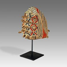 """ASHETU OR CEREMONIAL HAT, BASED BAMILEKE PEOPLE CAMEROON, WEST AFRICA 20TH C. HEMP 6'' W x 7'' D x 14'' H - The Ashetu is known as a prestige hat for dignitaries of the Bamun and the Bamileke peoples of the Cameroon Grassfield region...This one is made with handwoven fabric, decorated with multi-color trade beads. The burls or """"dreads"""" are crocheted over individual wooden pegs"""