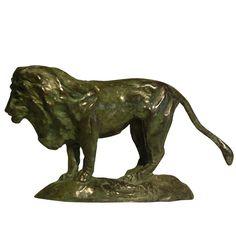 "Lion 3""H, 1""D, 5.5""W Green/brown patina"