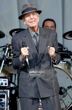 FESTIVAL Photo of Leonard COHEN, Leonard Cohen performing on the Pyramid stage