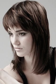 Choppy Brown Layered Shoulder Length Cut with Bangs
