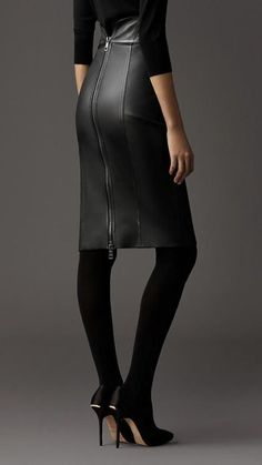 How to Rock a Leather Skirt - black skirt, black stockings & black heels. Love it!