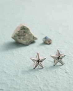 Mini Starfish Stud Earrings for pierced ears. Besides being sweet and charming, they will remind you how important it is to have one (or two) stars to aspire to. You can combine them with a matching ring, necklace, or bracelet.  The Mini Starsish Stud Earrings were designed as part of our 'Sea of Love' collection. כוכב ים קטן - עגילים צמודים