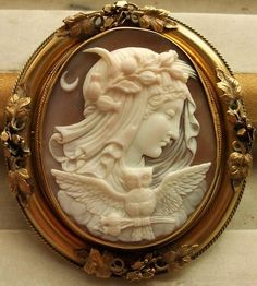 Cameo ca. 1840/50, Italy, English mounting. Museum quality cameo depicting The Allegory of the Night. The goddess Selene is depicted with her main attributes, as the poppies in her hair and the owl holding poppies in its pawns,  Moon and star are other two attributes of Selene.