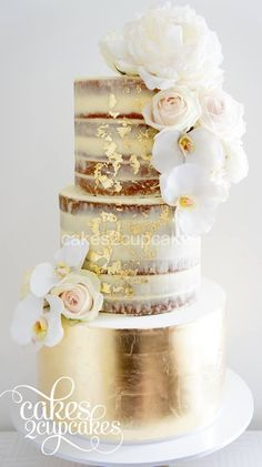 Half dressed or semi-naked wedding cake with gold leaf and fresh flowers by Cakes2Cupcakes.
