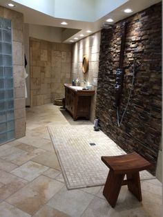 These homeowners created an incredible bathroom using 3.5 tons of travertine #tile and a stacked #stone accent wall on the shower. | Floor & Decor