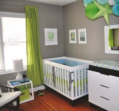 grey nursery with hints of green and blue, cute colors! I think Grey and baby blue would be cute for boy : )
