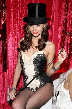 The model hosts the Sexy Circus Halloween party at Catch Rooftop in New York City and dresses, thematically, as a ringmaster.    - ELLE.com