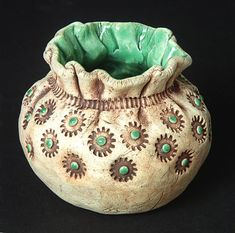 just like this textured pinch pot - rub wash in textures and wipe away - glaze inside with possible details on outside