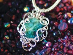 Double Strand wire jewelry pendant by Gayle Bird - from Freedom from Turkey with Freeform Wire Jewelry: Make Perfect Organic Wire Loops - Jewelry Making Daily