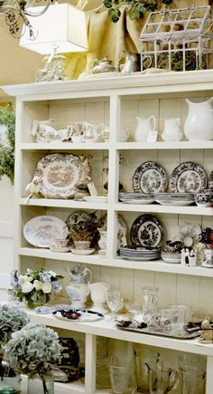 Antique transferware and ironstone in a variety of patterns and sizes
