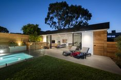 A beautiful place to entertain, rest and relax, or watch the children having fun in the pool. Outdoor and pool lighting create focus and warmth. A vertical garden grows above the hidden pool equipment and a garden shed is disguised behind the timber door. Interior Designers Melbourne, Hidden Pool, Timber Door, Pool Equipment, Pavilion, Building Design, Architecture Design, Beautiful Places, Shed