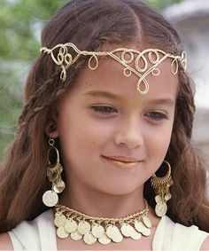 Who wouldn't worship this lovely greek goddess? Crowning the look is a pretty headpiece and gold coin jewelry. Greek goddess costume for girls is imported.