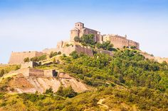 Some of the most beautiful castles in Spain - Castillo de Cardona. Ibiza, Barcelona Tours, Barcelona Spain, Cities, Medieval Fortress, Amazing Buildings, Beautiful Castles, Spain Travel, Vacation Destinations