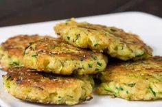 Zucchini patties: Super simple....1/3 C. Bisquick (maybe whole wheat pancake mix instead??), 1/4 C. Parmesan cheese, 1/8 t. Black pepper, 2 eggs (beaten), 2 C. Shredded zucchini, and onion. Fry them like pancakes in olive oil spread (like butter).