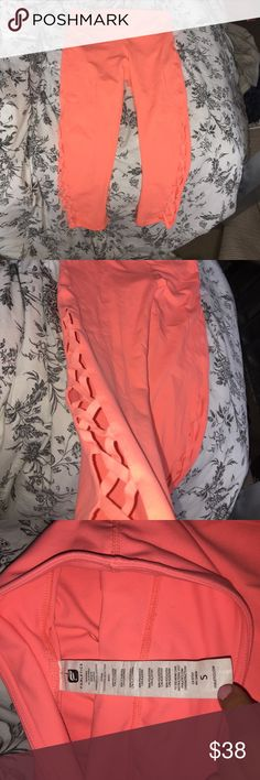Fabletics orange crop leggings Fabletics orange cropped leggings and side design. So cute on! Worn 3 times, in perfect condition!! Fabletics Pants Leggings