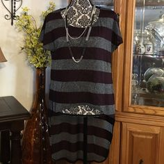 Ladie's high low fashion top Ladies Tela fashion top. High-low, color is striped burgundy blended with black, and grey with metallic. Really-really pretty top, easy to accessories for day to night wear. NWT, feel free to make offer :) Tops Blouses