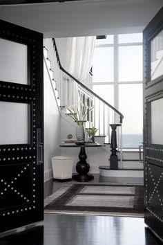 Black hand railing & Nailhead doors in a black and white palette