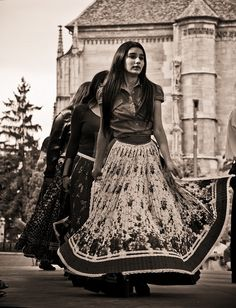 Gypsies in modern traditional dress by demartike, via Flickr - no description given but the castle suggests eastern europe and the group of dancers suggests a demonstration or street fair