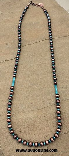Save 10% at www.gugonline.com by using the discount code GUGREPKCAR at checkout! Long Turquoise and Copper Navajo Pearl Necklace