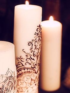 henna on a candle! DIY?  SN:  cool idea especially with home made scented candles. Adds finesse
