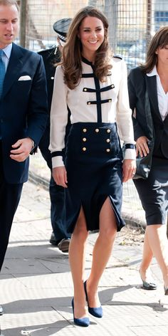 AUGUST 19, 2011 The Duchess of Cambridge visited a community center affected by the riots in Birmingham, England wearing a military-inspired blouse and skirt by Alexander McQueen, the same label behind her wedding gown.