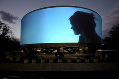 """Artist Doug Aitken's """"SONG 1"""" is an installation art piece, where video is projected 360 degrees around the Hirshhorn Museum in Washington, DC, played to a loop of covers of the song """"I Only Have Eyes For You"""". Beautiful. Photos and words can't describe the genius of this work."""