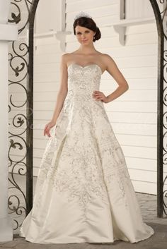 So stunning, similar to the mermaid style one but this is A-frame  Wedding Dress by SimplyBridal. With a beautiful sweetheart neckline and embroidery throughout its length, this gown is remarkable. The ball gown silhouette is emphasized by the corset back and ends with a short train. The rhinestone embroidery is the perfect addition to maintain the el. USD $899.99