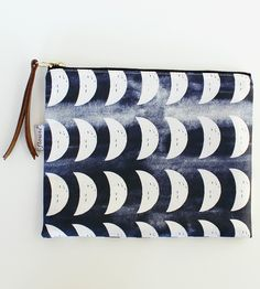 Crescent Moon Navy Canvas Pouch made by Flowie. Crafted with digitally printed fabric designed by the maker.
