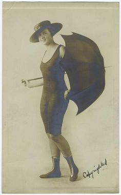 Woman In Bathing Suit With Parasol, 1917.] From New York Public Library Digital Collections.