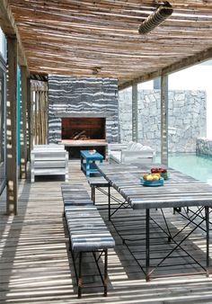 Uruguayan beach house with stone fireplace. Love the lattice