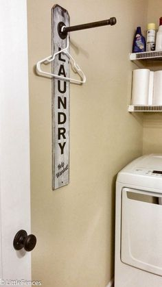Laundry Room Sign, Industrial Pipe Clothing Rack, Laundry Room Hanging Rack, Wall Decor, Hooks, Organization, Storage, Wall Art, Rustic Wood by LittleFences on Etsy https://www.etsy.com/listing/481443564/laundry-room-sign-industrial-pipe