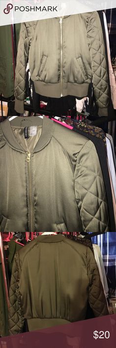 Army Green Bomber Jacket Sz. 4 Worn once purchased a year ago. Plain only a front zipper that's gold & two pockets. Quilting on the sleeves. Extremely soft. By the H&M divided brand. H&M Jackets & Coats