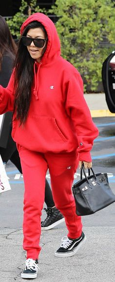 Kourtney Kardashian' in Sunglasses – Saint Laurent  Purse – Hermes  Sweatshirt and pants – Champion  Shoes – Vans