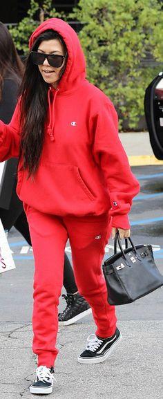 Kourtney Kardashian' in Sunglasses – Saint Laurent  Purse – Hermes  Sweatshirt and pants – Champion  Shoes – Vans