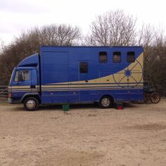 This horsebox has a large shutter door, allowing the storage of a carriage in the living section