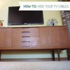 How-To: Hide those Pesky TV Cables- we just finished doing this to hid our tv cables and it worked perfectly! I love how clean it looks Hide Tv, Credenzas, Tv Cabl, Tvs, Hiding Cords, Bullet, Bedroom, Diy Projects, Tv Cord