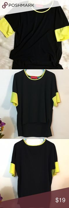 Akira • Relaxed Black and Yellow Tunic Top Drapey black tunic from Akira Chicago red label. Short sleeves with a bright pop of yellow add a cheerful touch to this staple top. 95% polyester 5% spandex, no flaws. AKIRA Tops
