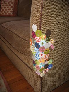 covering cat scratching damage  this is hiliarious- it is like quilt bombing instead of yarn bombing . repair with some hexies! can crochet granny squares to do same thing :)  i am making a border for my couch from puppies chewing on it