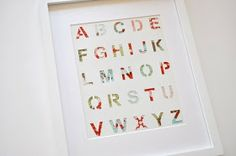 Alphabet stencil painted white with fabric behind