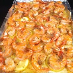☆.•♥•Simple Lemon Butter Baked Shrimp Recipe!•♥•☆  All you need to do is : Melt a stick of butter in a pan. Line the baking sheet with tinfoil Slice one lemon and layer it on top of the butter. Put down fresh shrimp, then sprinkle one pack of dried Italian seasoning. Put in the oven and bake at 350 for 15 min Simple and delicious! Add beer to the butter when you're melting it...