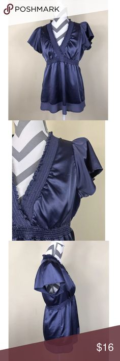 "🌷BCBGMaxazria Midnight Blue Silk HighWaist Blouse Excellent Pre-loved Condition! BCBG Maxazria Midnight Blue Silk Short Sleeve High Waist Blouse w/ V-neck   Size: Women's Small Measured laying down flat:  26"" long, 17"" across bust, 6"" long sleeves Material: 100% Silk Description: Very Pretty & Dressy Pullover, high elastic waist, deep V-neck, light weight and flowy bottom, short sleeves BCBGMaxAzria Tops Blouses"