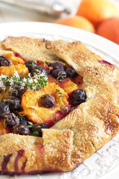 Easier than pie! This Apricot Blueberry Thyme Galette recipe is simple to make and ready in less than 30 minutes.   @suburbansoapbox