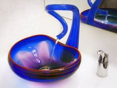 The Cobalt Blown Glass Vessel Sink with Red Lip is a designer blown glass bathroom sink in cobalt blue glass with hand-applied red lip edge. Glass Bathroom Sink, Glass Vessel Sinks, Bathroom Ideas, Bathroom Gadgets, Sink Faucets, Bath Ideas, Bathroom Designs, Bathroom Island, Seashell Bathroom