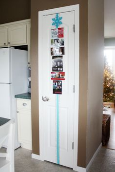 Tape a decorative ribbon to a door and attach Christmas cards - great way to display them all.