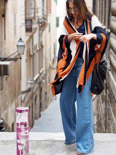 #poncho #cape #stripes #retro #wrapped #oversize #oversized #trends #spring #highwaist #denim #jeans #balenciaga #bags #style #streetstyle #mallorca #fashion #blogger #berlin #ootd #helloshopping #flares #instyle #vogue #elle #madame #cosmopolitan #boho #bohemian