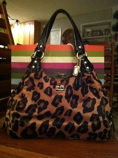 Leopard Coach Gia purse...  My boss got this Coach a few weeks ago, luuuuurrrve it!