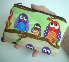 too cute!  Owls in Line Little Zipper Pouch Coin Purse Gadget case (Padded) -Out of Print. $9.00, via Etsy.